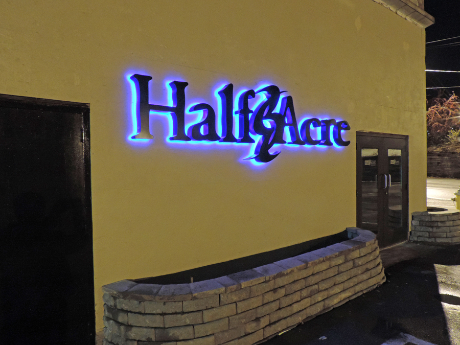 Reverse-lit channel letters look best with a significant, uniformly colored wall behind them. The flat surface behind the letters allows for nice contrast with the LED halo lighting.