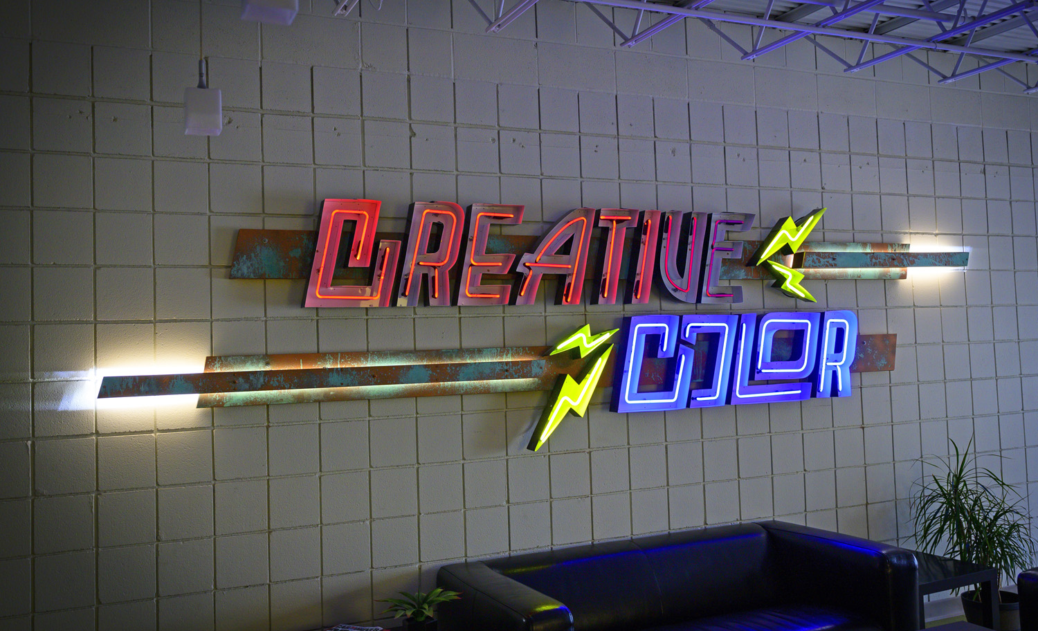 Creative Color (Minneapolis) fashioned this striking sign with open-faced neon channel letters for itself.