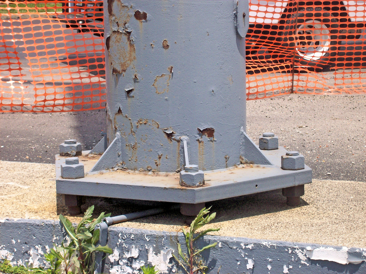 Periodic inspections of anchor bolts and base-plate welds are essential for proper sign maintenance.
