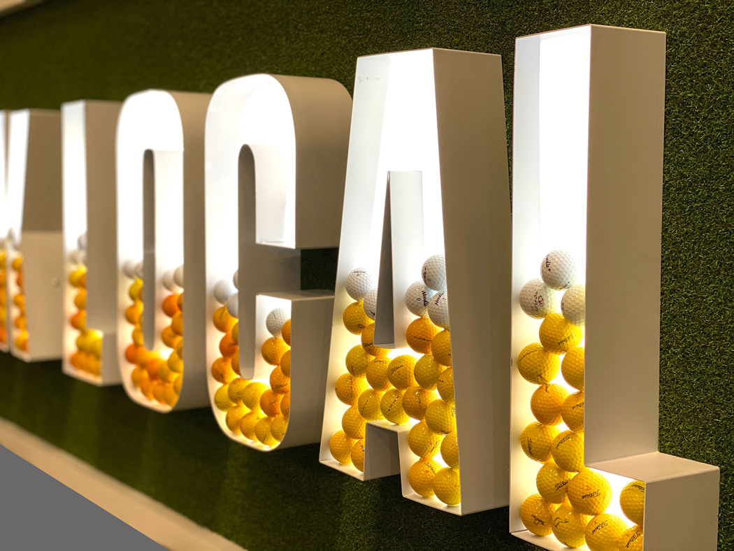 Amigo Arts' illuminated sign for Flatstick Pub boasted real AstroTurf and golf balls to look like beer-filled letters.