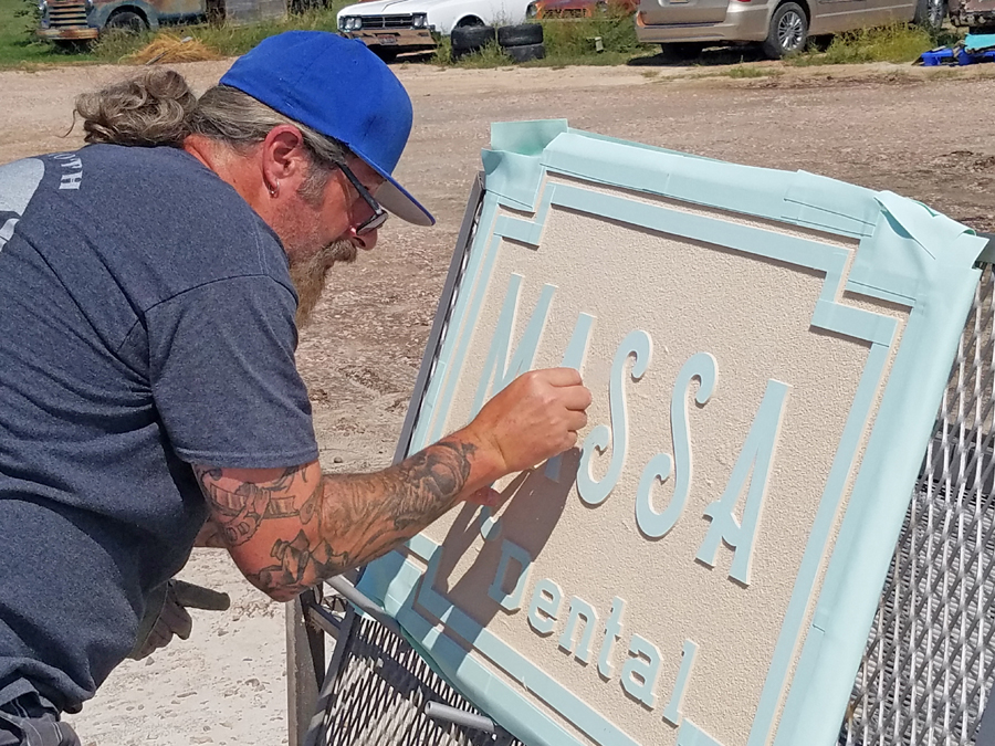 Nitro Alley Inc. sandblasted the main sign, and afterwards Curt Lout inspected the mask and depth of the blasting.